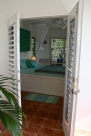 Master bedroom through veranda doorway